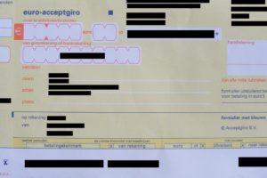 Kifid: Verzekeraar mag acceptgiro nog niet bij het oudpapier doen